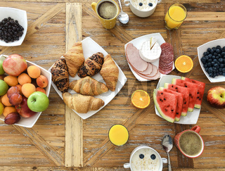 High angle of healthy delicious breakfast on wooden table in morning