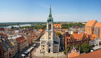 Church of the Holy Spirit surrounded by buildings in Torun