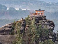 Breakfast or picnic of tourists on lookout tower Mariina vyhlidka