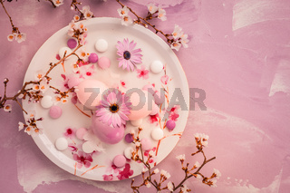 Pink Easter eggs with blooming branch