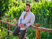 Young Man Outdoor Leaning on Wood Fence