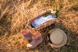 Set of country style clothes on dry hay