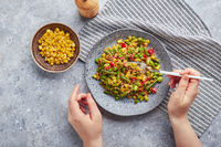 Quinoa salad with green beans, corn, red bell peppers, peas and soybeans. Useful vegetable mix