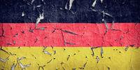 Wandfarbe von Deutschlandfahne blättert ab