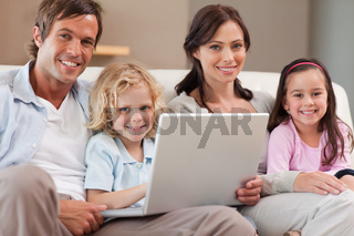 Calm family using a notebook
