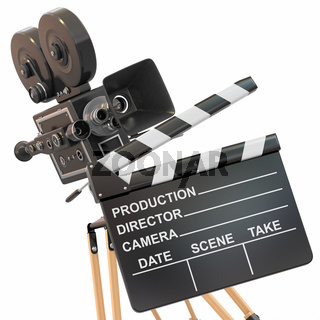 Movie composition. Vintage camera and clapperboard