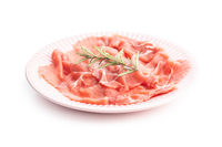 Sliced carpaccio. Raw beef meat on plate.