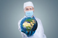 Doctor hold a earth globe in hands and a medical syringe with vaccine against corona virus. 3D rendering. Elements of this image furnished by NASA.