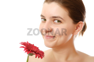 Young woman with a red flower on white background