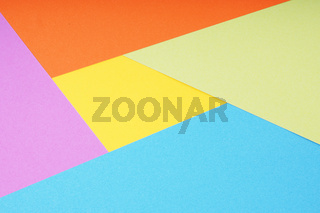 multicolor paper background with 5 different colors in triangle and rhombus shapes