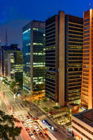 Paulista avenue seen at night with its illuminated buildings