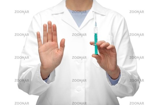close up of doctor with syringe shows stop gesture