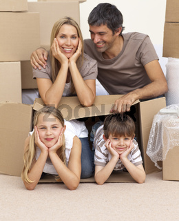 Family moving house playing with boxes