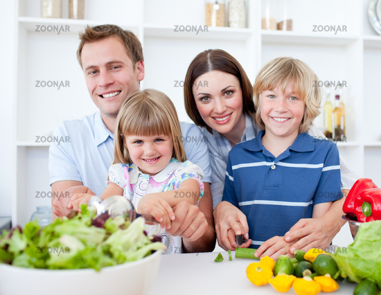 Cheerful young family cooking together