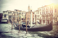 Gondola moored in channel in Venice, Italy