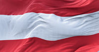 Close-up view of the national flag of Austria waving in the wind. Democracy and independence.