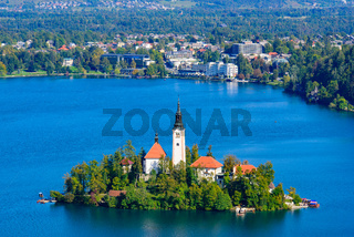 Aerial view of Bled Island and Lake Bled from Osojnica Hill, a popular tourist destination in Slovenia