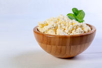 Homemade cottage cheese with a sprig of mint.