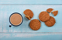 Oatmeal cookies and pannikin of hot chocolate