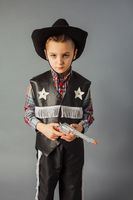 The little boy in a sheriff's costume full length