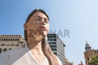 Large paper mache statue of a meditating women on the town square 'Placa de L' Ajuntament' for the Fallas event in Valencia, Spain
