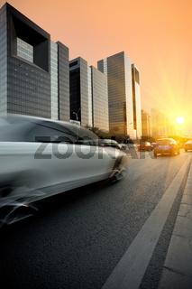 dusk traffic on modern street