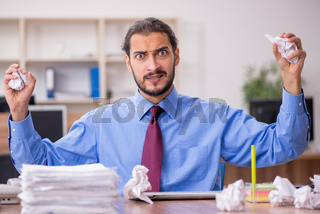Young male employee in brainstorming concept
