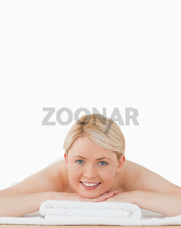 Young beautiful blonde woman posing in a spa centre