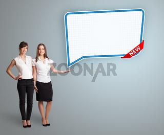 young women presenting modern speech bubble copy space