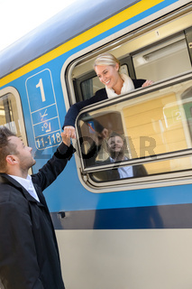 Woman leaving with train man farewell couple