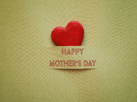Happy Mothers day on a green background