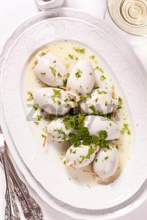 Sepia stuffed in white wine sauce