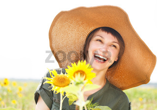 Portrait of a young smiling woman with sunflower