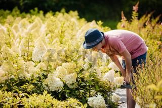 Handsome teenage boy choose flower for mother's day