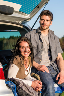 Camping young couple smiling together