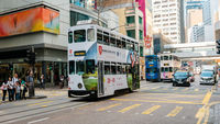amous historic double-decker tram car on the street of Hong Kong Island