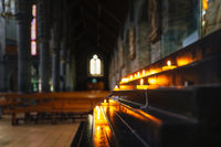 Selective focus on votive lit candle in St. Marys Cathedral in Killarney