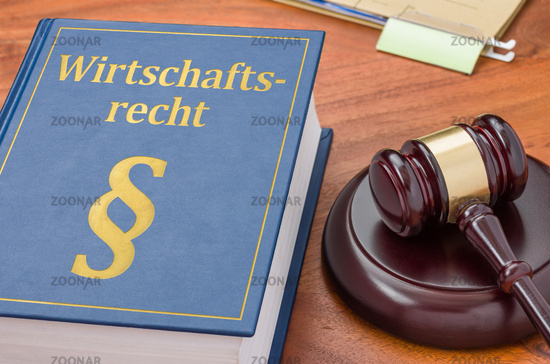 A law book with a gavel -  German Translation of Commercial law - Wirtschaftsrecht