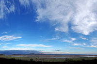 panoramic view of the coast at grange over sands in cumbria at twilight with grass covered wetland in the foregrounds and the north lakes area in the distance