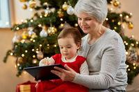 grandmother and baby girl with christmas gifts