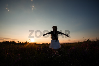Girl feeling happy being connected with the nature