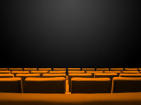 Cinema movie theatre with orange seats rows and a black background