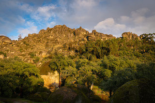 Landscape view of Monsanto castle and Picoto highest point in boulder and tree landscape, in Portugal