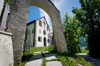 Entrance to the small village church of the alpine mountain area in Mieming, Tirol, Austria