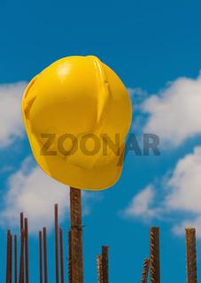 Construction helmet on steel bars