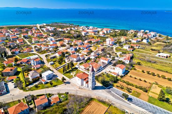 Privlaka village near Zadar tourist destination church and waterfront aerial view