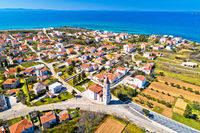 Privlaka village near Zadar tourist destination church and waterfront aerial view