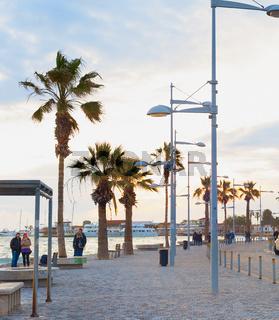 Tourists promenadesunset  Paphos  Cyprus