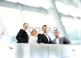 Successful business people on railing