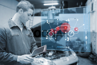 Mechanic using tablet and futuristic interface in black and white